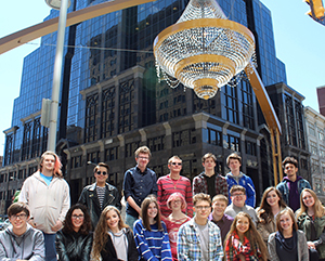 Album cover for Living in the Moment. Group photo of Midview High School songwriting students under the outdoor chandelier in Cleveland's Playhouse Square
