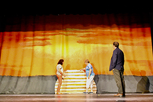 Ohio Arts Council Organizational Programs Coordinator Jim Szekacs looks at a backdrop created for the Huber Opera House's production of The Lion King, Jr.
