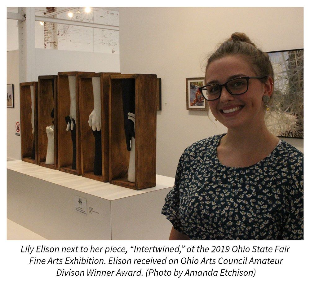 Artist Lily Elison next to her piece, Intertwined, at the Ohio State Fair Fine Arts Exhibition.