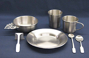 A photo of pewter dinnerware made by Willa Hollingsworth