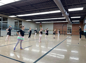 A photo of masked students in a ballet class at Richland Academy of the Arts