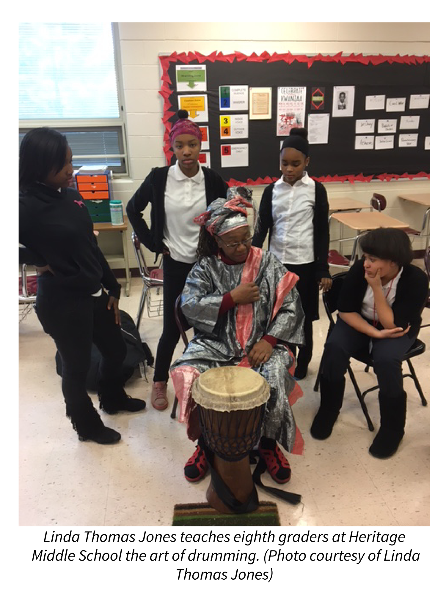 Linda Thomas Jones teaches eighth graders at Heritage Middle School the art of drumming. Photo courtesy of Linda Thomas Jones.