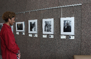A student looks at artwork on display in the Ohio Civil Rights Commission's office lobby in Columbus.
