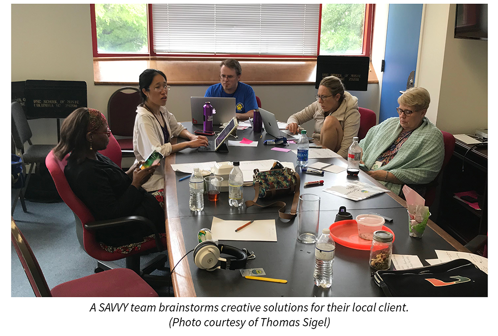 A SAVVY team brainstorms creative solutions for their local client