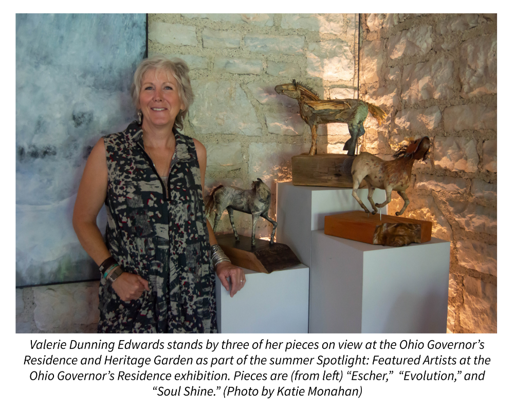 "Valerie Dunning Edwards stands by three of her pieces on view at the Ohio Governor's  Residence and Heritage Garden as part of the summer Spotlight: Featured Artists at the Ohio Governor's Residence exhibition. Pieces are (from left) ""Escher,""  ""Evolution,"" and ""Soul Shine."" (Photo by Katie Monahan)"